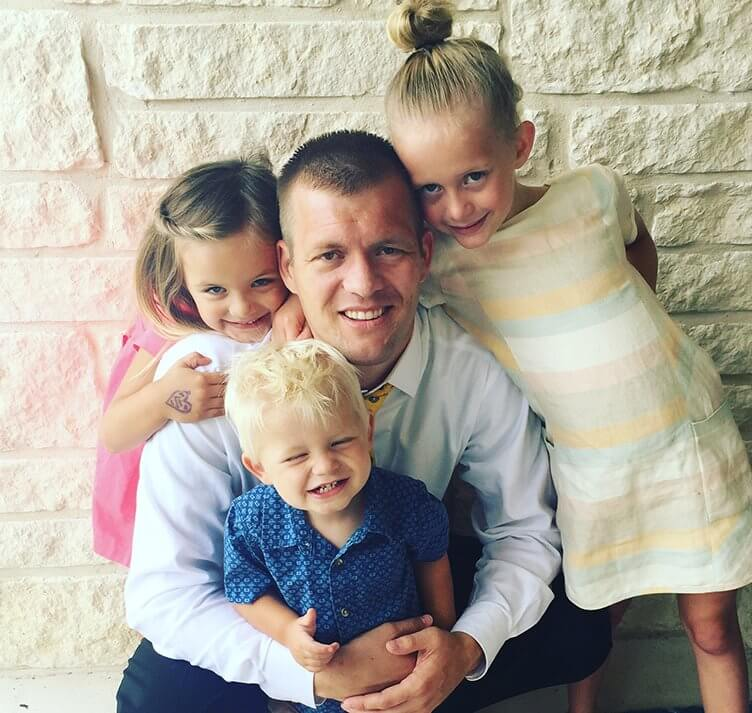 Dr. Tanner Hunsaker and three of his children at Midtown Dental in Logan, Utah