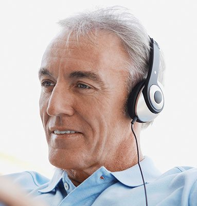 Older man with headphones on