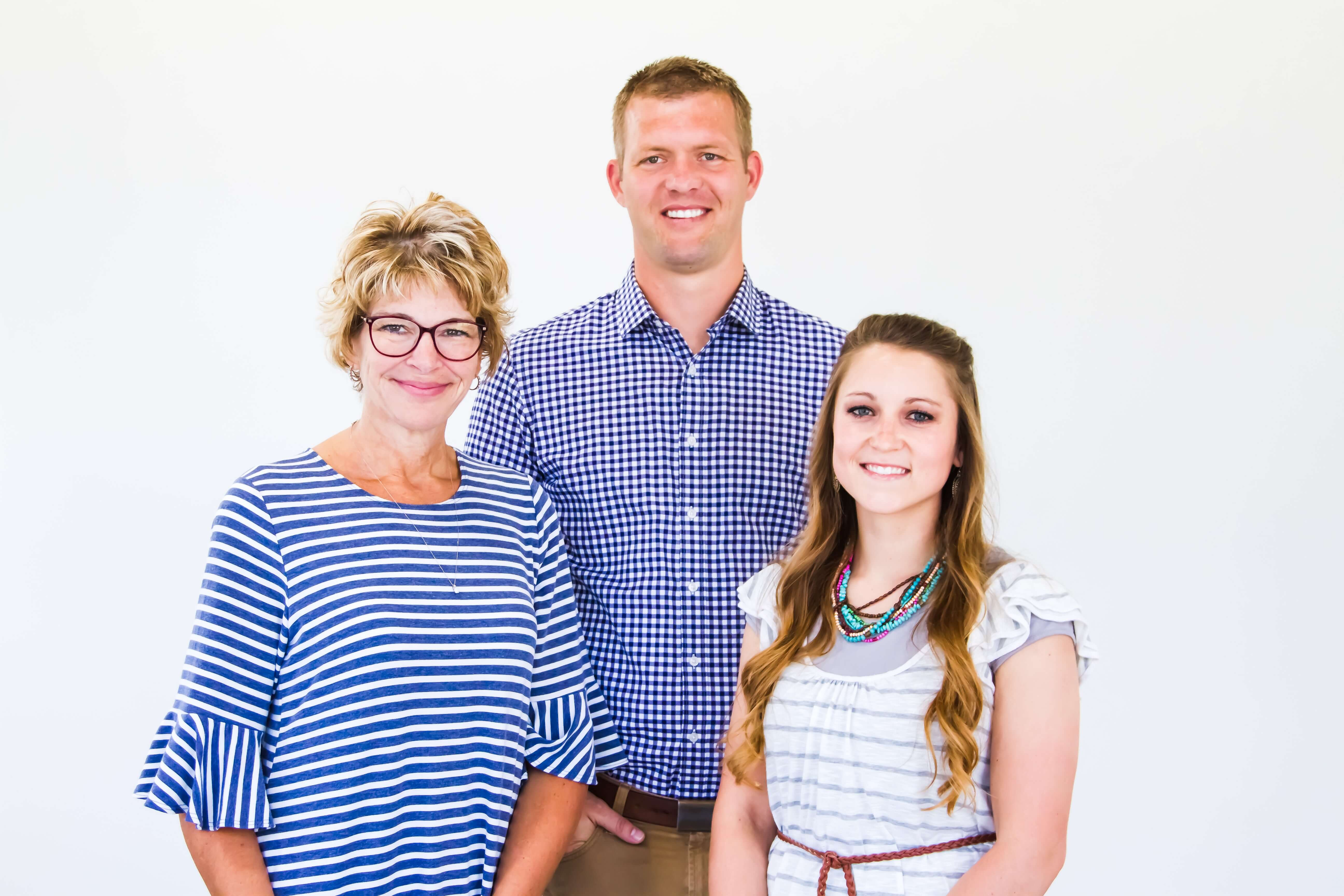 Dentist in Logan, Dr. Tanner Hunsaker and his dental team group photo at Midtown Dental in Logan, Utah