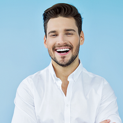 Young man in a white shirt smiling wide