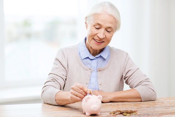 Elderly Woman saving money