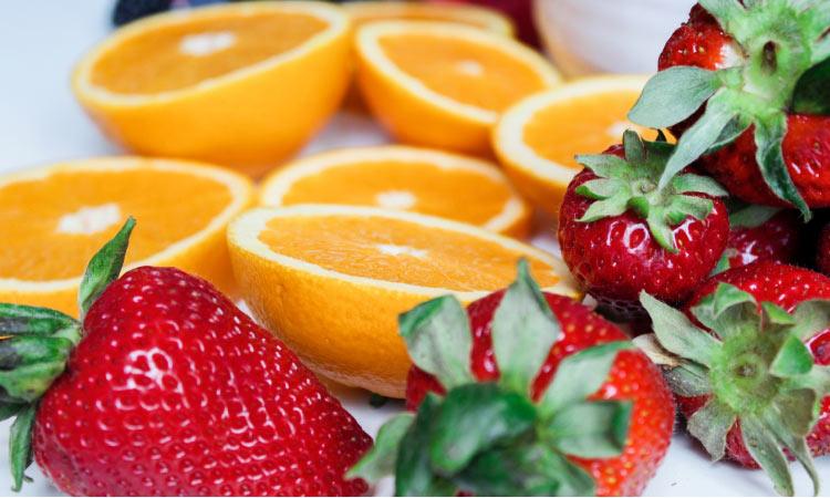strawberries and oranges help strengthen teeth