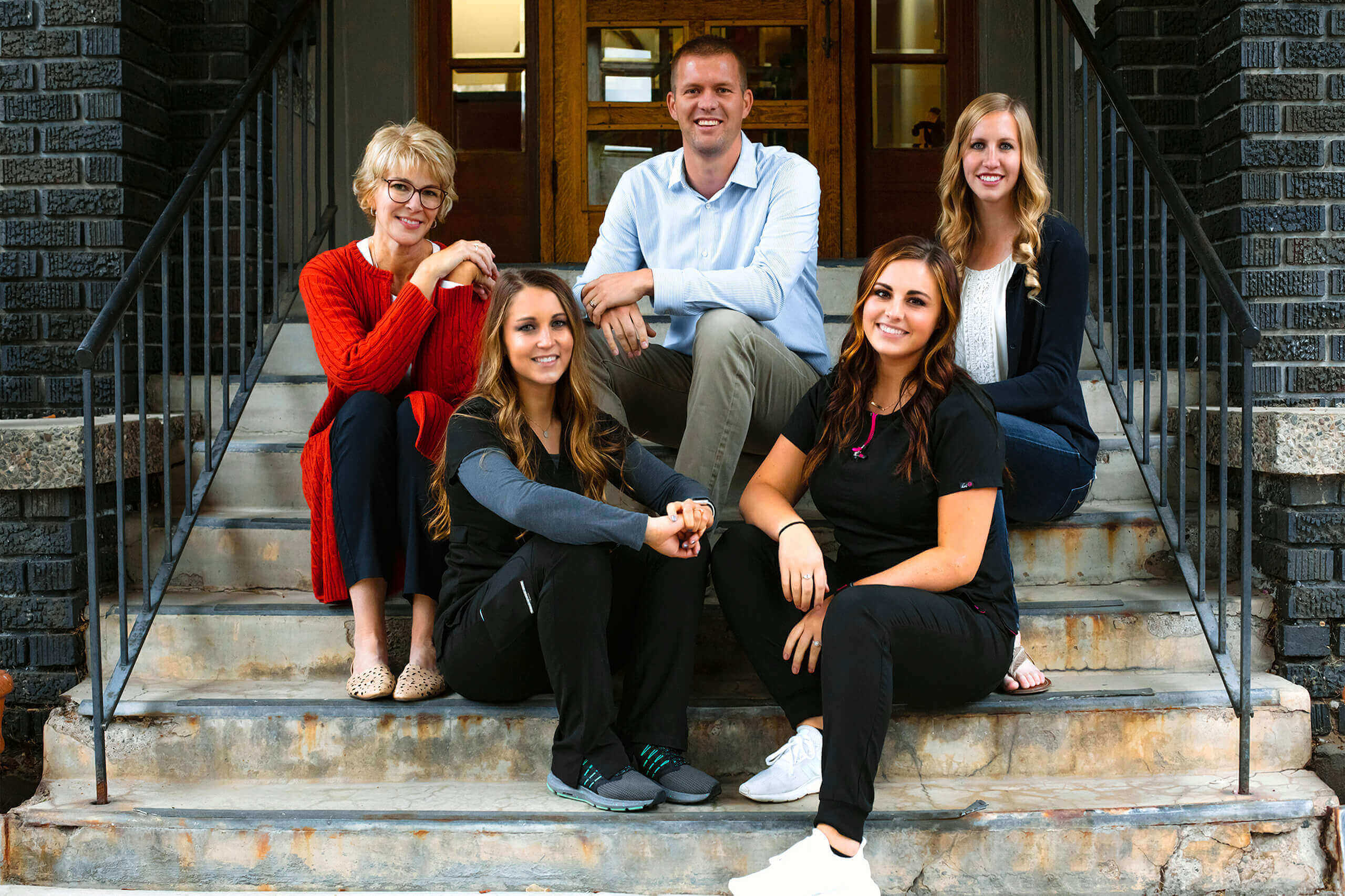 Dentist in Logan, Dr. Tanner Hunsaker and his dental team group photo at Midtown Dental in Logan, Utah