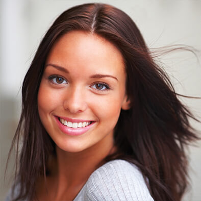 Brunette woman smiling with white teeth