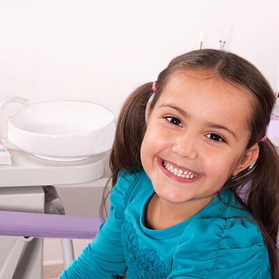 Young girl smiling wide during her dental visit