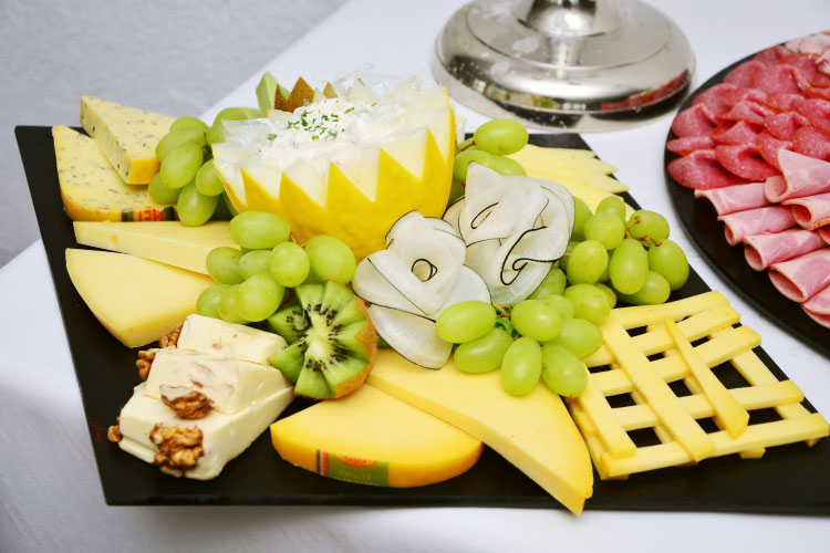 Closeup of a cheese platter for a summer barbecue