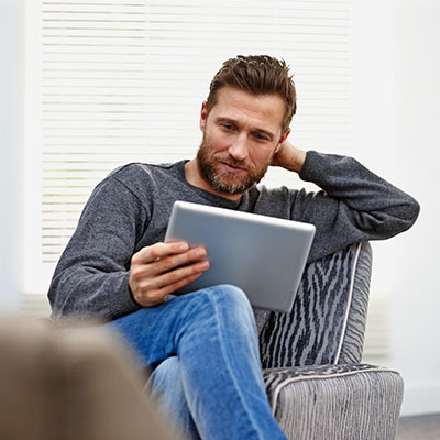 a man looking at a tablet